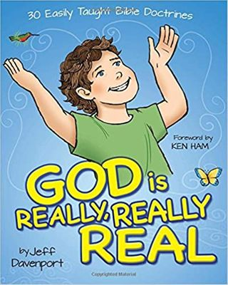 Young boy with green t-shirt on with his hands raised praising God proclaiming God is really, really real with blue background.